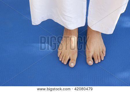 Feet On A Blue Mat