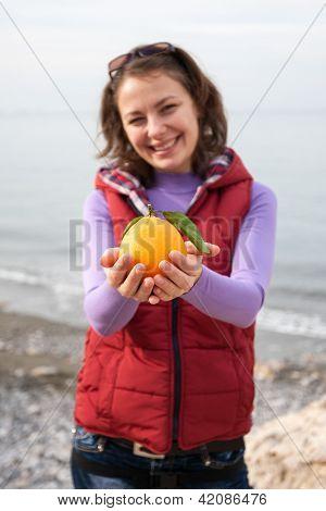 Orange In Palm Of Hand