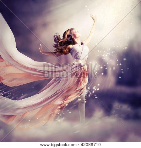 Fashion Art Beauty Portrait. Beautiful Girl, Model Woman wearing Long Chiffon dress. Magic. Miracle. Fantasy Scene