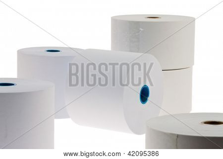 white paper rolls lying on a white background. isolated and exempt