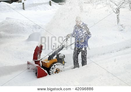 Man is blowing snow