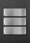 three stainless steel metal plates