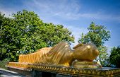 stock photo of sanctification  - A big golden statue of Buddha sleeping - JPG