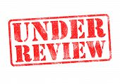 picture of financial audit  - UNDER REVIEW red rubber stamp over a white background - JPG