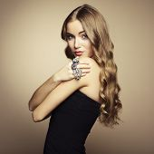 image of beads  - Portrait of beautiful blonde woman in black dress - JPG
