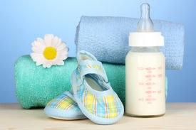 image of teats  - Baby bottle of milk with baby - JPG