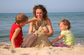 picture of summer beach  - mother with children playing with sand on beach - JPG