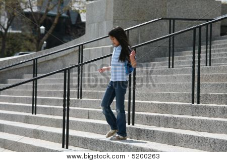 Little Girl Walking Down Granite Steps