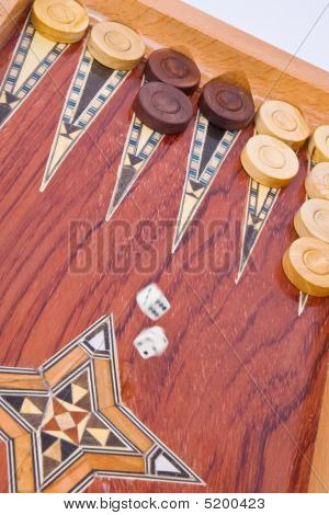 White Dices Falling On Wooden Handmade Backgammon Board Isolated