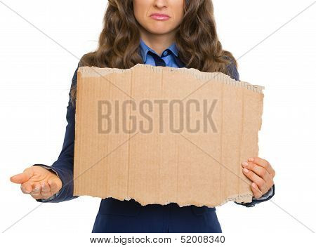 Closeup On Frustrated Business Woman Showing Blank Cardboard And