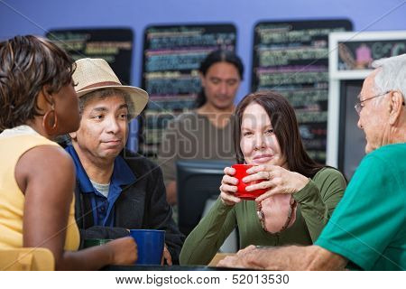 Glad Woman With Friends In Cafe