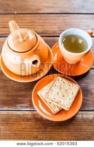 Top View Of Hot Tea Cup And Crackers