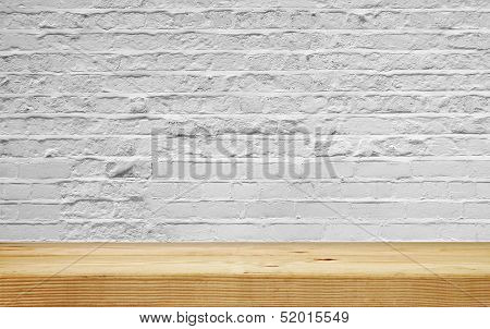Empty Shelf On White Brick Wall