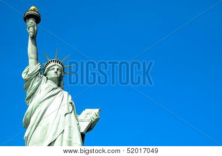 Statue of Liberty on blue clear sky