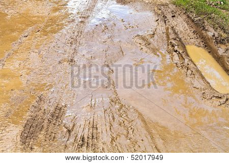 Mud And Puddle At Dirt Road
