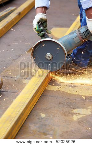 Worker Cuts Metal