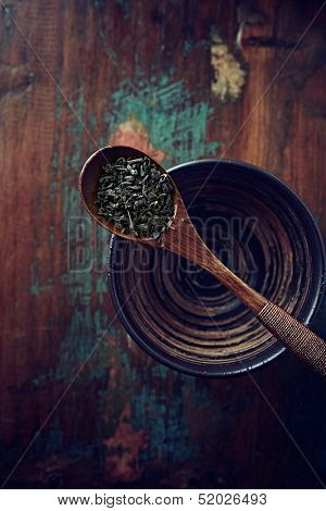 Green tea leaves (gun powder) on a wooden tea spoon