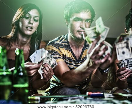 teens at party gambling and doing drugs