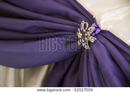 White And Purple Drapes With Brooches
