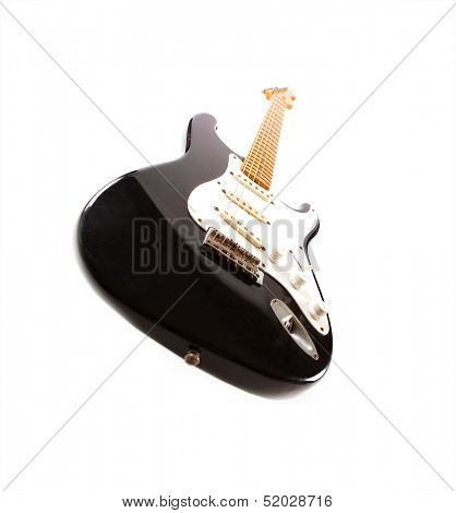 Vintage black electric body guitar, isolated on white.