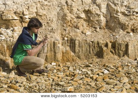 Young Geologist Studying Rock Type
