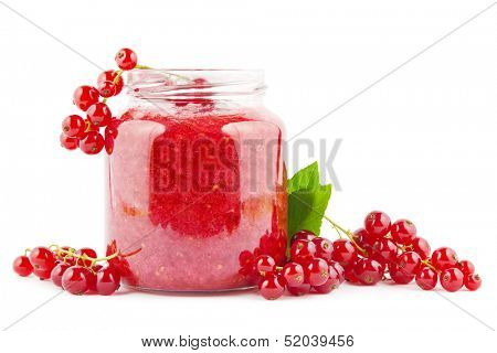 Fresh homemade red currant jam with currants on white