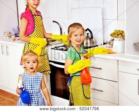 Children little girl cooking at kitchen.