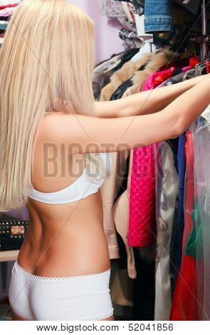 Woman in a wardrobe