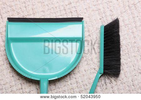 Green Sweeping Brush And Dustpan On Floor - Housework