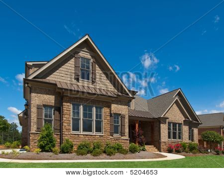 Model Luxury Home Exterior Angle View Sidewalk