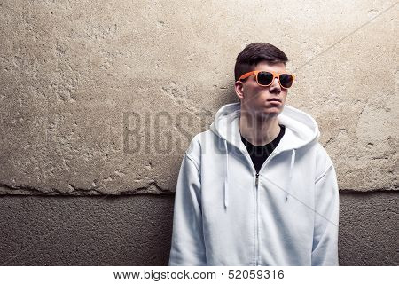 Street Portrait Of Young Boy In White Sweatshirt With Orange Modern Eyeglasses