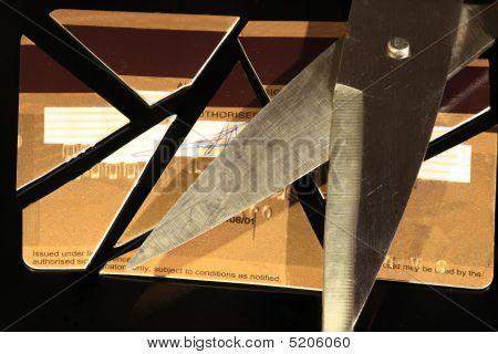 Cut Up Credit Card And Scissors