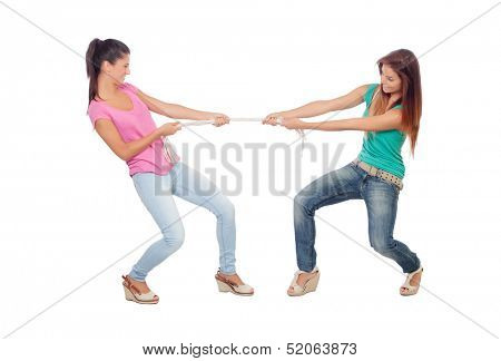 Two beautiful women pulling a rope isolated on a white background