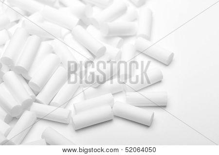 Pile of white un-used cigarette filters