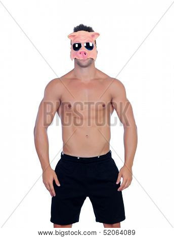 Muscular man with a pig mask on a white background