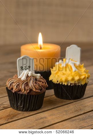 Halloween cupcake and candle close-up
