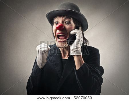 portrait of a happy clown talking on the phone