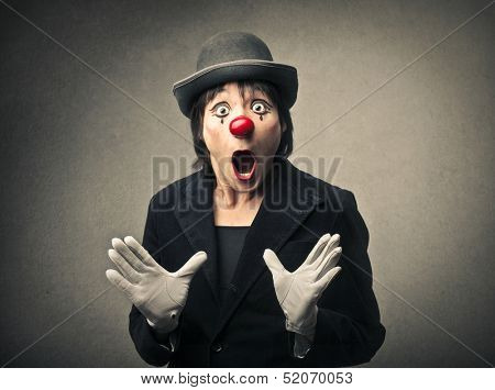 portrait of an amazed clown with open mouth
