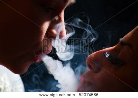 beautiful girls in smoke with hookah