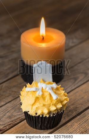 Halloween pumpkin cupcake and candle