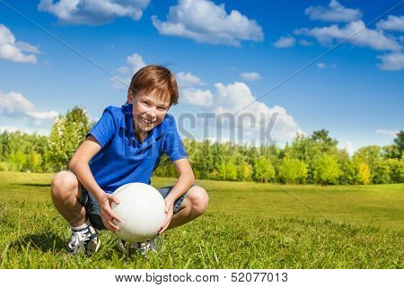 Boy Sit In Squads With Volleyball Ball