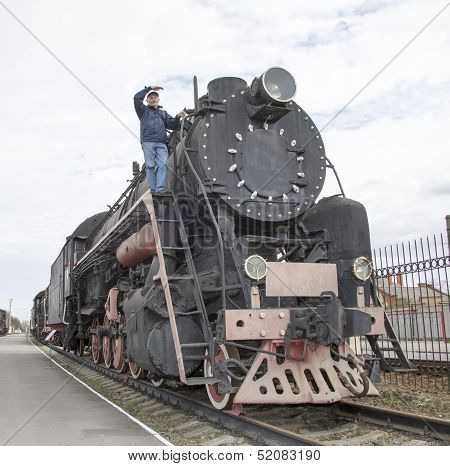 The Machinist Of A Steam Locomotive Looks Afar