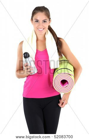 Beautiful young girl with gym mat at home