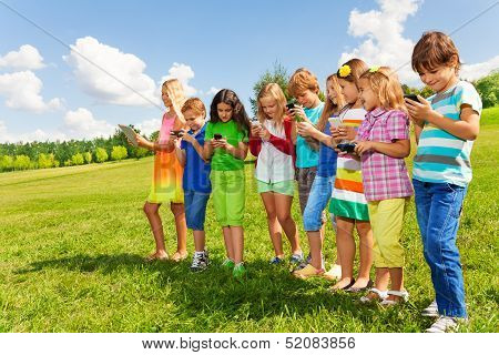 Group Of Kids With Phones