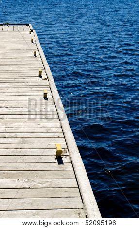 Wooden Dock On Blue Water