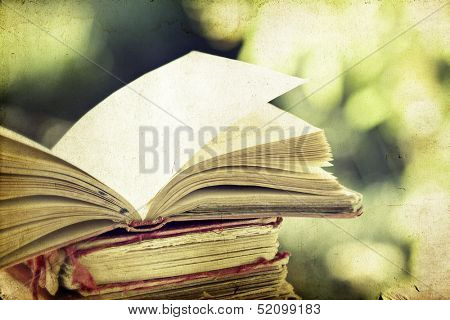 Vintage photo of old books on colorful bokeh background