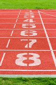 image of 8-track  - Start Line on Red Eight Lanes Running Track - JPG