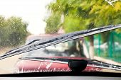 foto of wiper  - Car wipers wash windshield when driving in rain