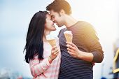 stock photo of amusement  - romantic couple with ice cream at amusement park - JPG