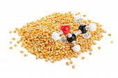 stock photo of ethanol  - Ethanol chemical model on corn kernels - biofuel concept